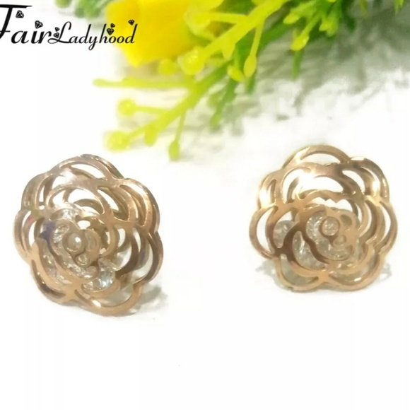 ae06fc29a3110 Rose gold Camellia earrings.